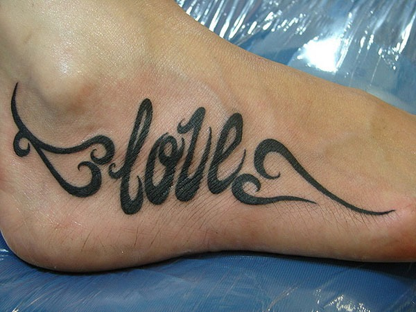 letter tattoo on foot