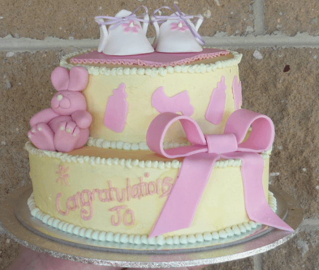 Yellow baby shoes topper cake